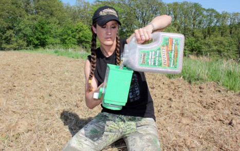 Pouring food plot seed
