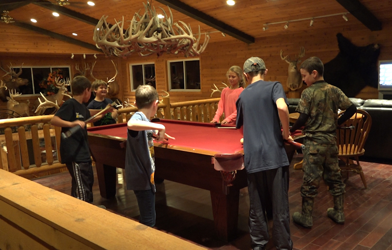 kids_playing_pool_in_camp